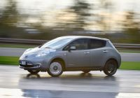 smiling-and-sideways-in-a-nissan-leaf